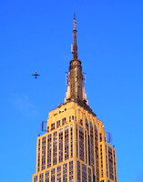 Shot from the roof of 115 W 30th Street in NYC. 4 blocks north of the Empire State Building. Plane was on approach to La Guardia Airport.