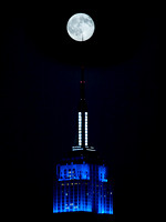 Get the point? Empire State Building 10/4/09 Full Moon. The building tonight was illuminated in Blue Blue and White for the Juvenile Diabetes Research Foundation, Walk to Cure Diabetes